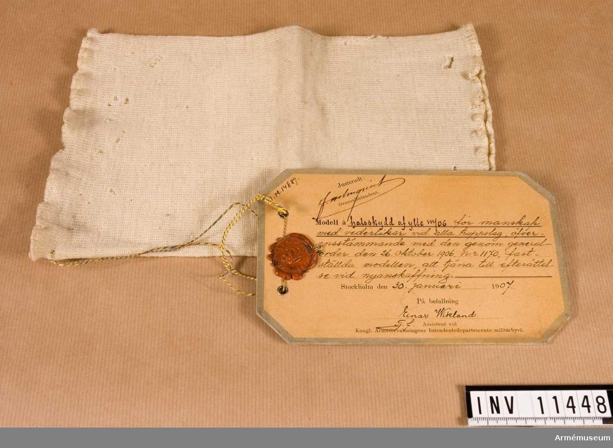 Halsskydd m/1906, manskap.Grupp C I.Halsskydd av ylle m/1906 för manskap av alla truppslag.  Förmodad gåva.