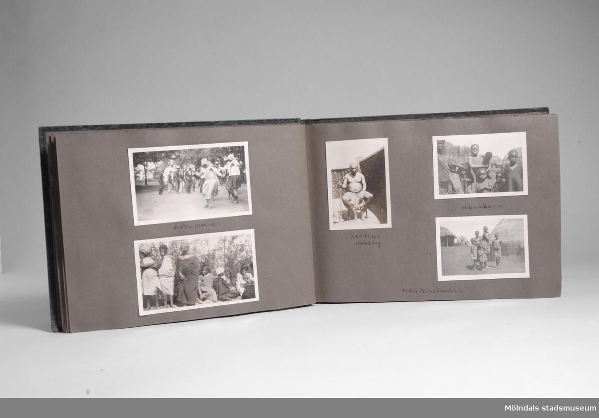 Fotografialbum som tillhört missionären Helga Andreasson. Albumet börjar med bilder från Roodeport 1932.Helga Andreasson växte upp i Mölndal och efter avslutad skolgång utbildade hon sig till sjuksköterska och diakonissa vid Bräcke diakonianstalt. År 1931 reste hon ut till Zululand i Sydafrika och arbetade där som missionär för Svenska Kyrkans Mission. I närmare 40 år kom Helga Andreasson att arbeta i Sydafrika med kyrka och mission. Givaren Lilly Nygren är syster till Helga Andreasson, som var äldsta systern i en barnskara av sex.Foton, diabilder, böcker mm. efter Helga Andreasson finns förvarade i Föreningsarkivet i Mölndal.