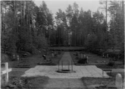 Skogskyrkogården Gravkvarter med brunn i förgrunden