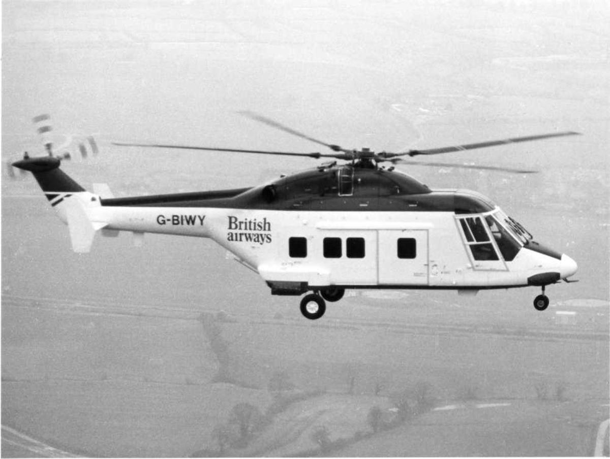 Ett helikopter i luften, Westland 30. Merking G-BIWY