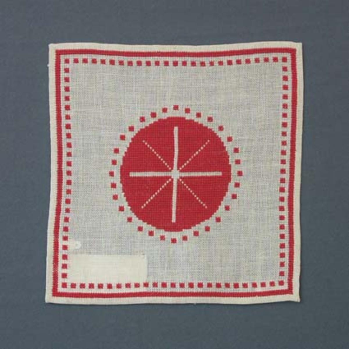 Julduk med korsstygnsbroderi på linneväv.Material med mönster 22:-.