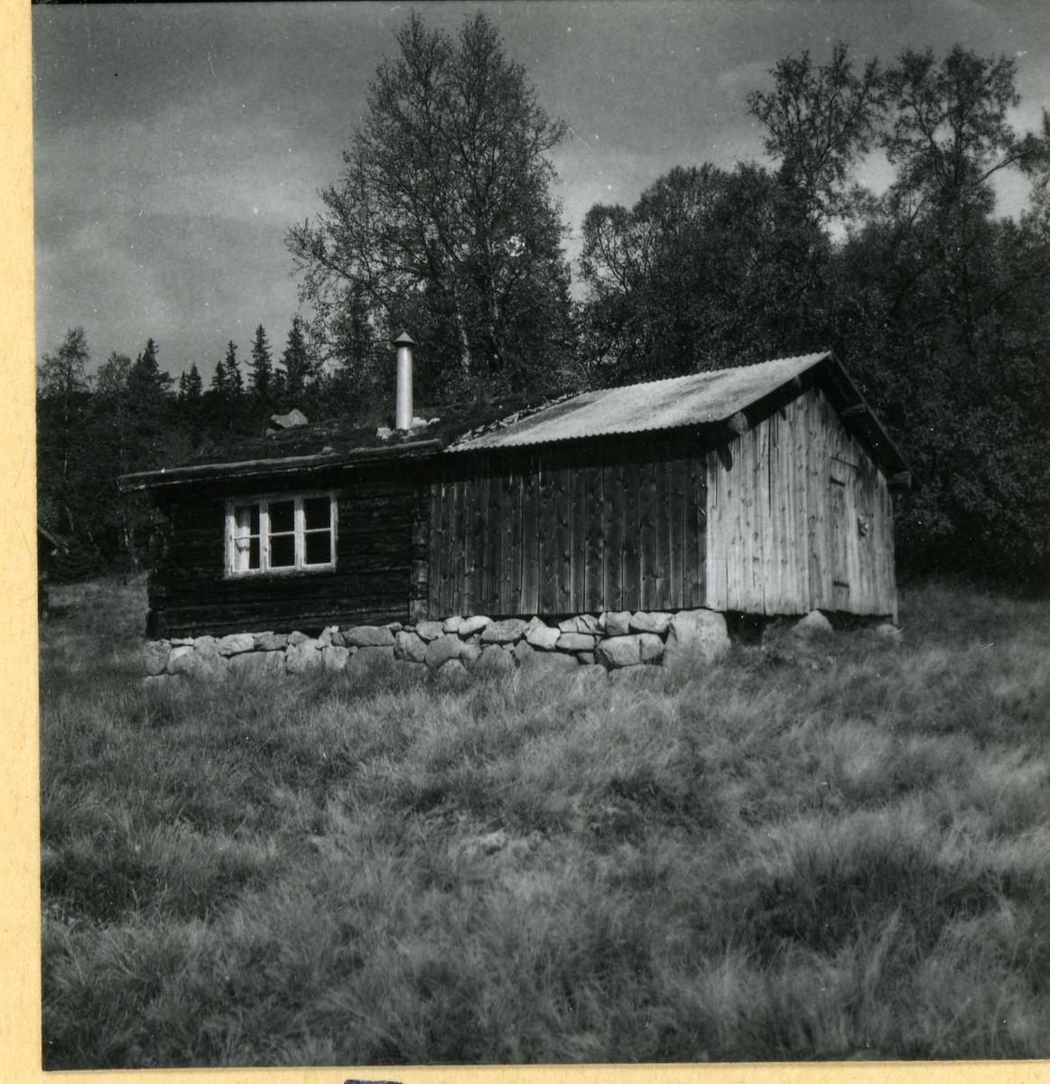 338  Lafta hytte med uthus.