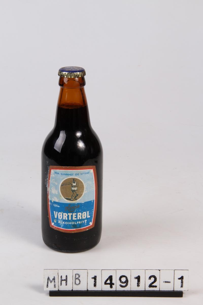 Ølflaske med etikett og kork.