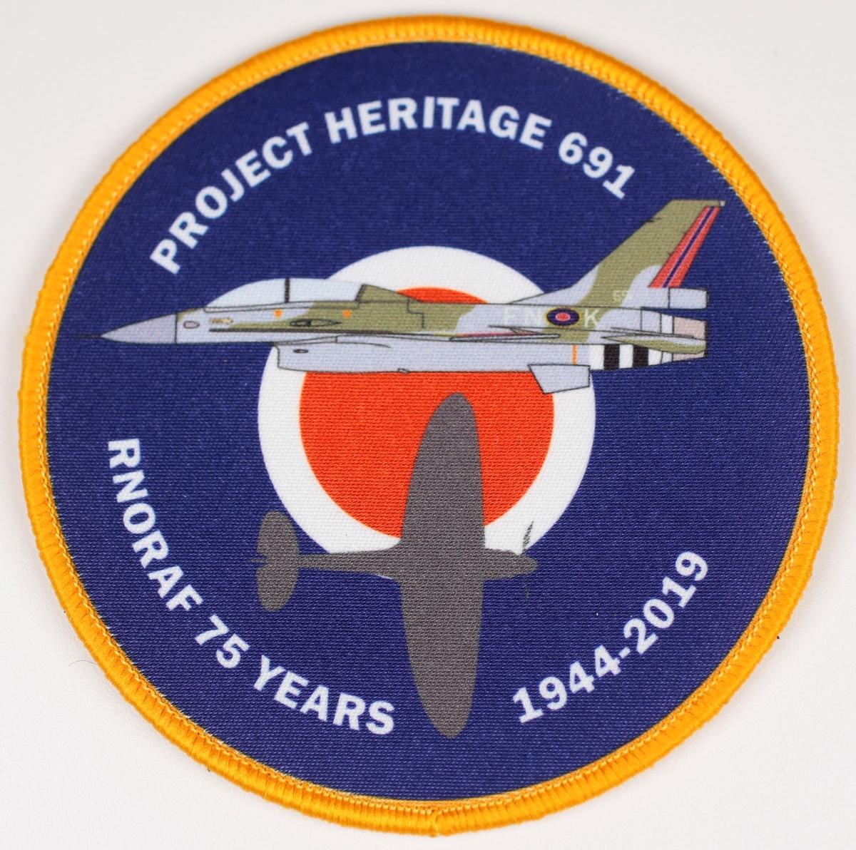 Patch utgitt ifm Luftforsvarets 75-års jubileum. Motivet er en F-16 og en Spitfire med nasjonal merke som bakgrunn.