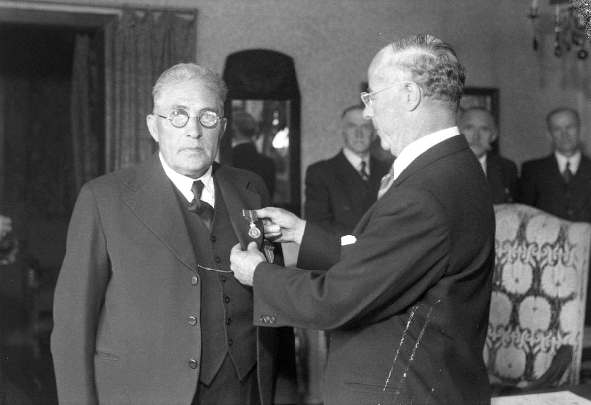 Formann Johan Sivertsen får medalje