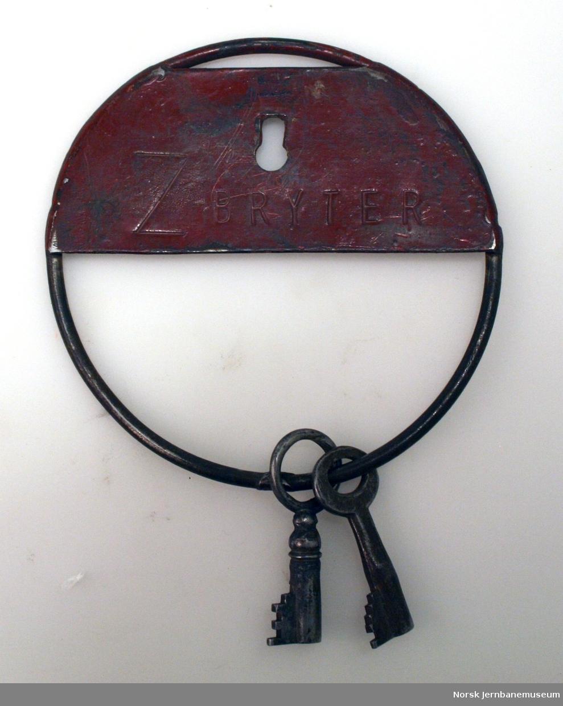 """Rundt nøkkelskilt merket """"Z Bryter"""" med 2 nøkler"""