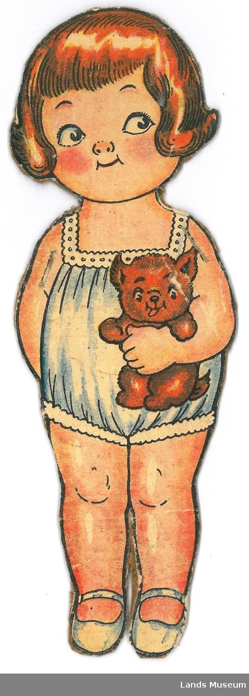 Papirdukke med klær, klipt ut frå utklippsark. Dukken er montert på papp.  A- dukke, jente med brunt hår og bamse, 20 x 6,5 cm B- søndagskjole, gul, 7 x 7 cm C- Hollenderdrakt, 10 x 11 cm D- kjole, grønn, 8 x 7 cm E- kjole, rød med blå, 8,5 x 9,5 cm F- badedrakt, 7 x 11 cm G- kjole, rutet 9 x 6,5 cm H- blå kjole, 9 x 7 cm I- stranddrakt, grøn med elefant, 7 x 10 cm J- lue, gråblå, 4 x 6,5 cm K- kåpe, rød med gul sløyfe, 10 x 7 cm L- kåpe, rød med veske, gul kjole, 8,5 x 9 cm M- hatt, gul hatt med roser, 5,5 x 9,5 cm