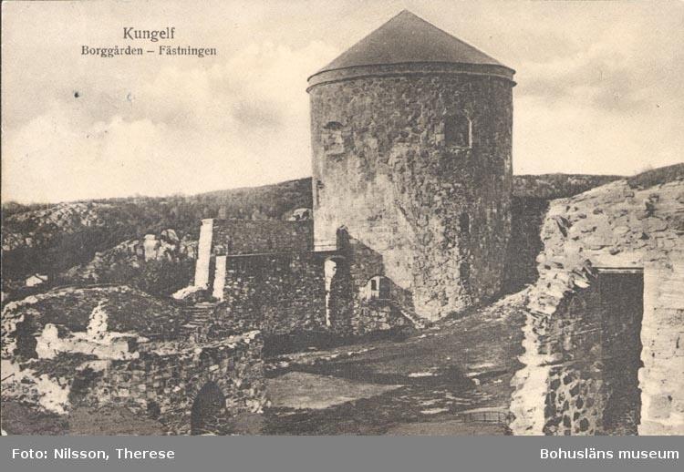 """Tryckt text på kortet: """"Kungelf Borggården- Fästningen"""".       ::"""