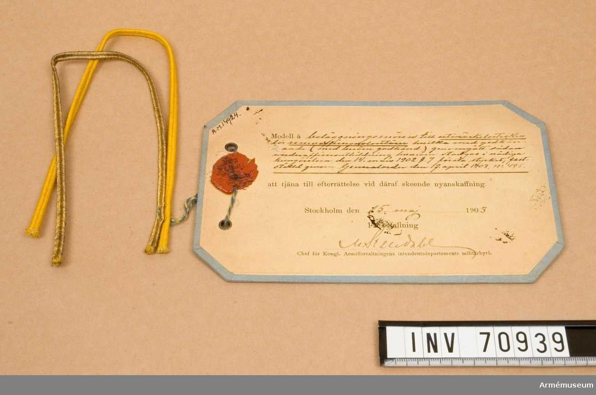 Grupp C:I.   Beläggningssnöre m/1903 till utmärkelsetecken för reservofficersvolontärer,vilka med godkännande /med beröm godkänd genomgått underofficers utbildningen,