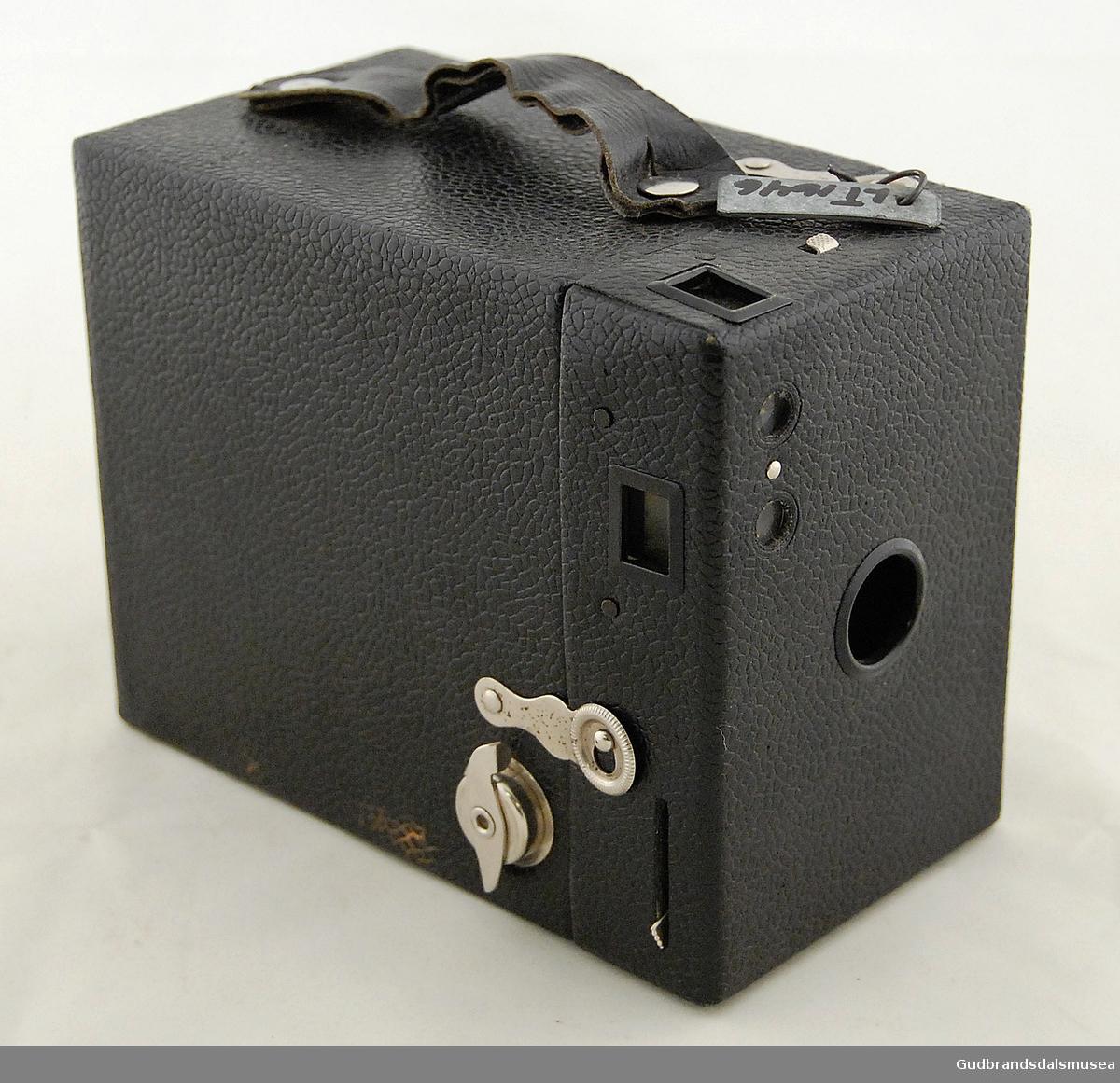 Fotoapparat i svart lær.