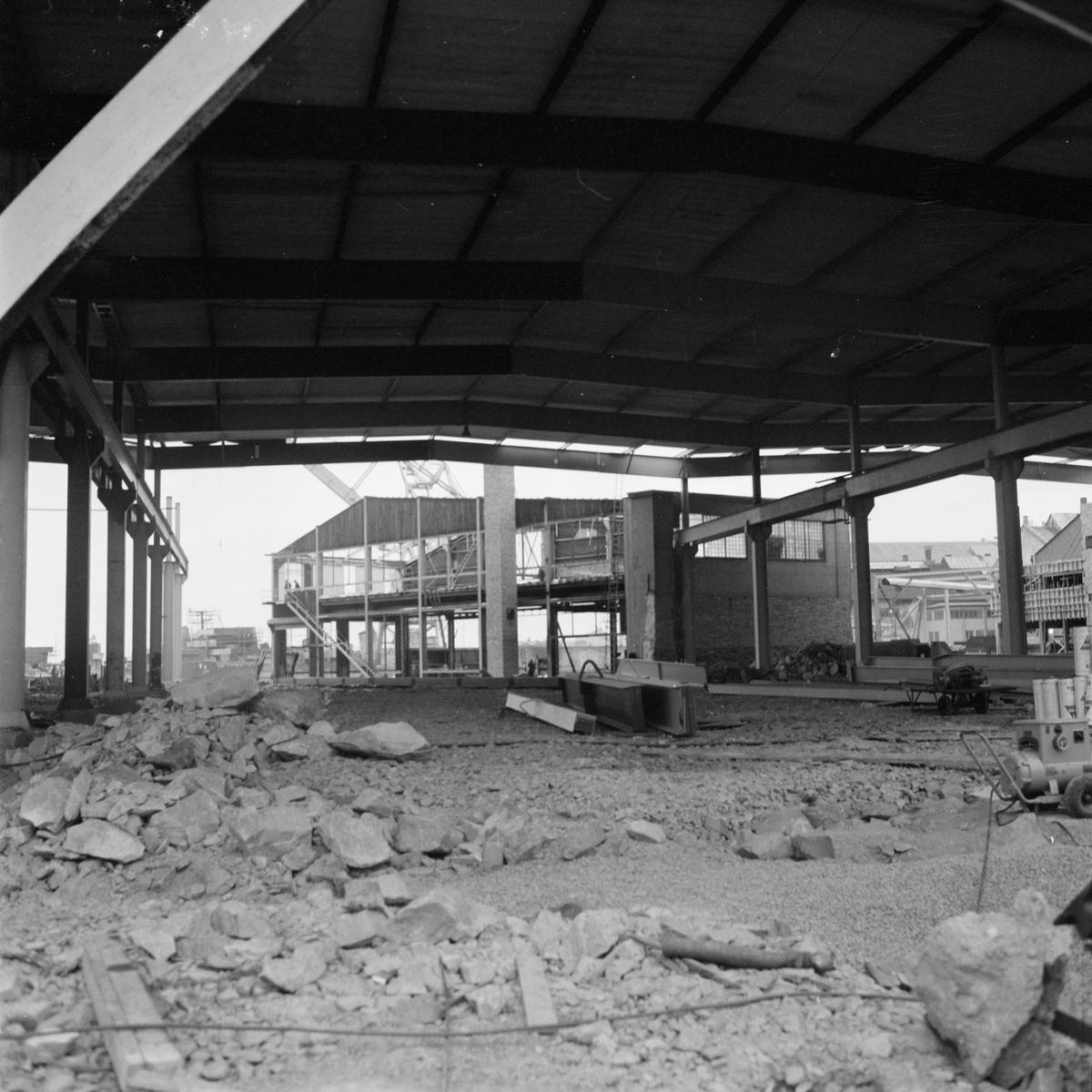 Övrigt: Fotodatum:9/11 1962. Byggnader och Kranar. Nybyggnations område. Kraftcentralen och Plåtverkstan