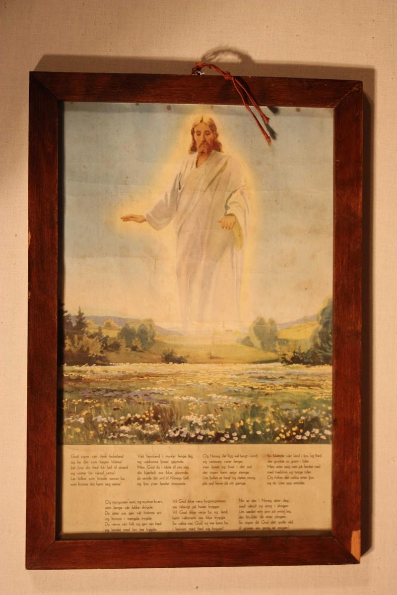 """Jesus held sine velsignande hender over eit landskap. Under biletet er skrive fedrelandssongen """"Gud signe vårt dyre fedreland"""", 7 vers."""