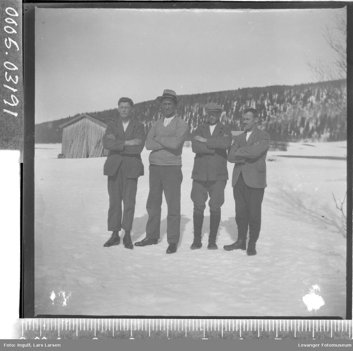 Gruppebilde av fire menn.