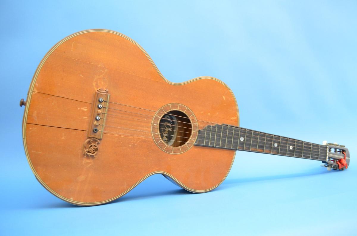 Akustisk gitar med seks stålstrenger.