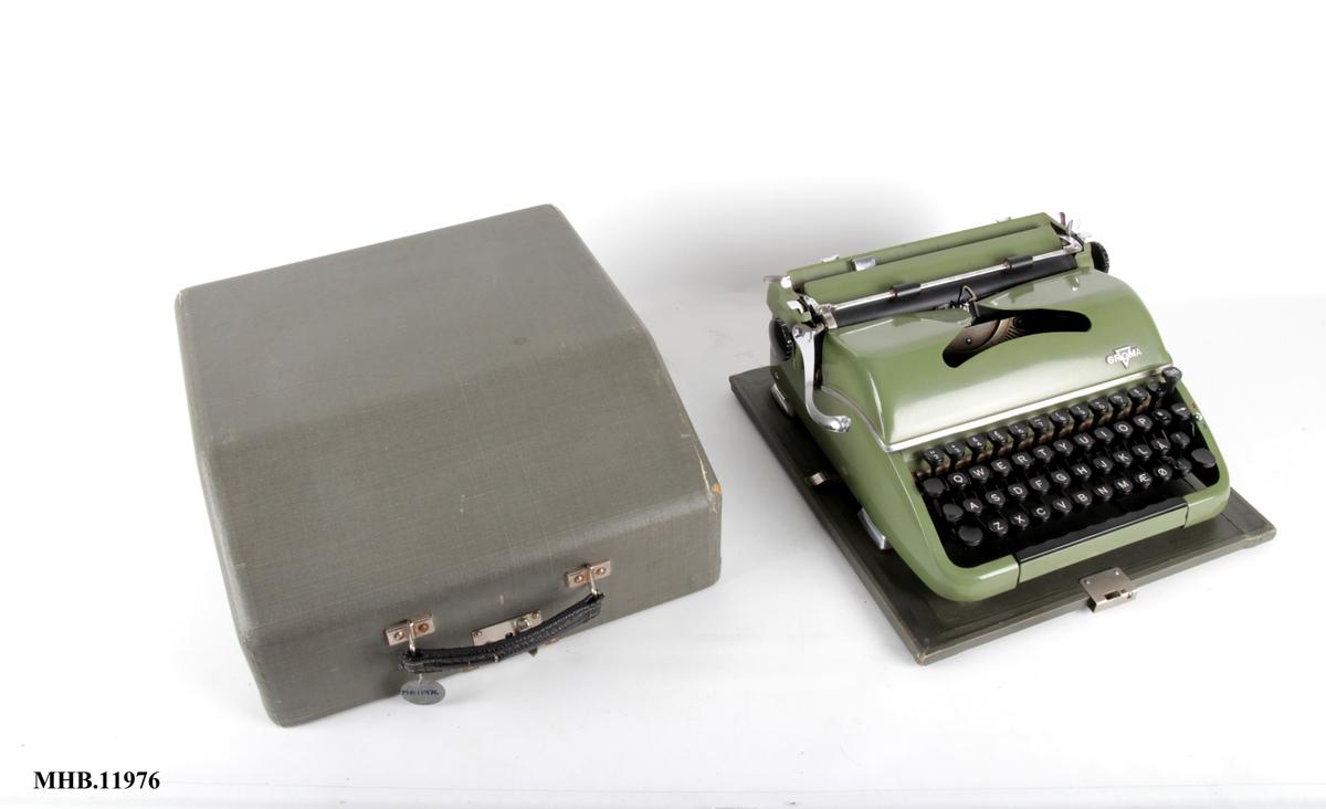 Reiseskrivemaskin med koffert.