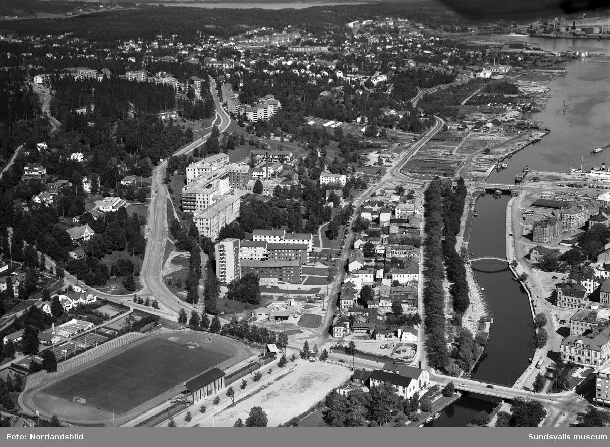 Flygfoto tagen från selångersån och Idrottsparken mot nordost med Tivolivägen, lasarettet, Norrliden, Heffners och Skönsberg.