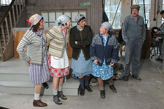 """Paper hens in the play """"Working Days""""."""
