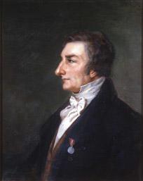 Portrett av Christian Kollerud. Profil. Mørk drakt, rødbrun vest. Medalje på venstre jakkeslag.