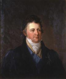 Portrett av grev Herman Wedel Jarlsberg. Mørk drakt, gul vest og hvit skjorte. Blått ordensbånd, orden festet på brystet.