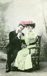 Postkort kolorert fotografi av mann og kvinne