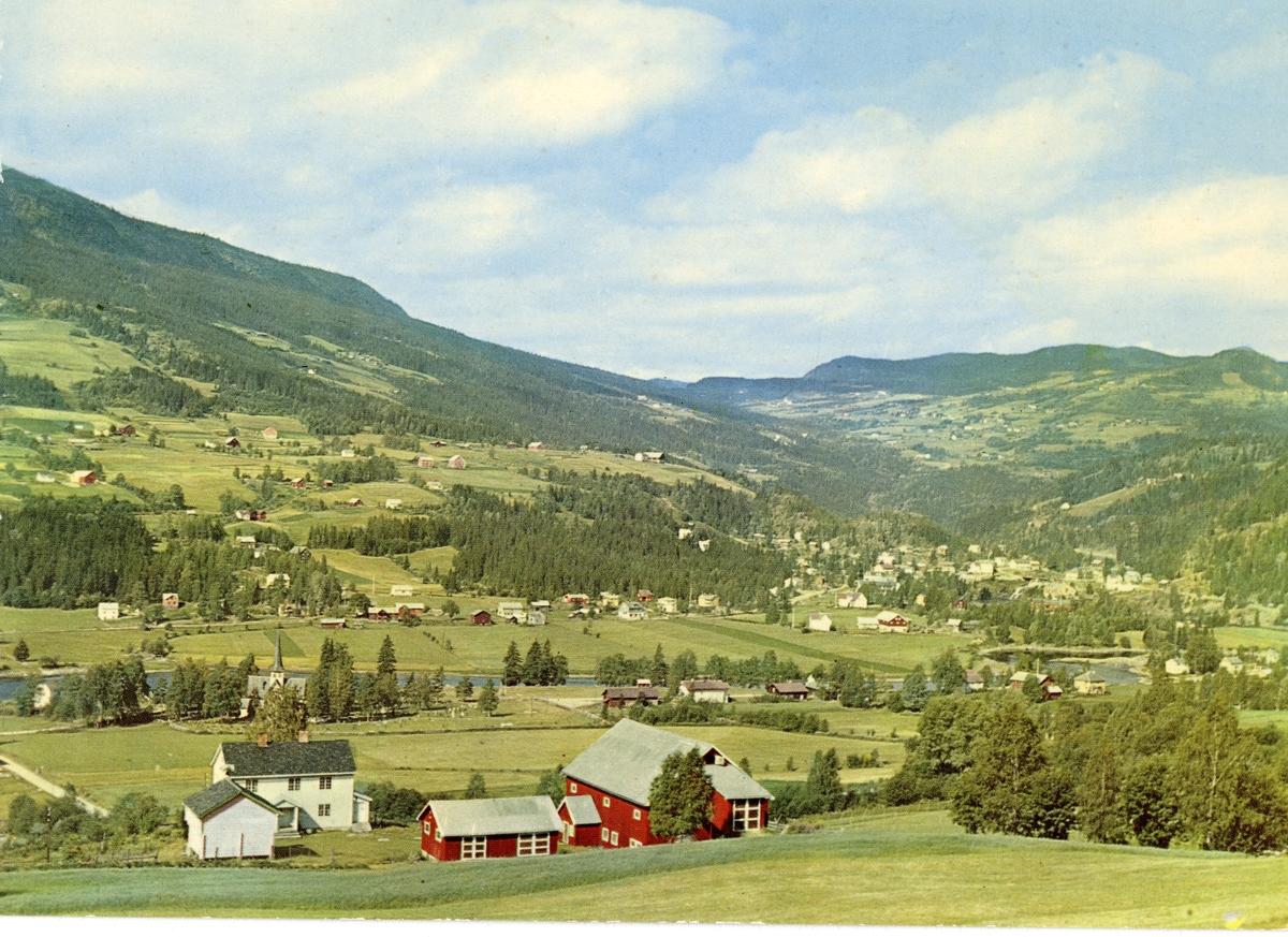 Postkort med utsikt mot vestre Bagn. Bygda Reinli ligger opp til høyre.