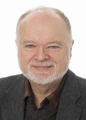 Portrett av avdelingsdirektør Knut Djupedal ved Migrasjonsmuseet.