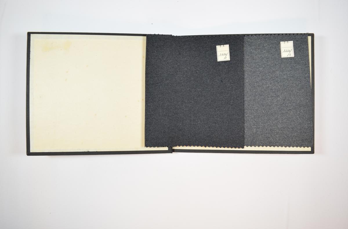 Rektangulær prøvebok med to stoffprøver og harde permer. Permene er laget av hard kartong og er trukket med sort tynn tekstil. Boken inneholder middels tykke melerte stoff skrå striper. Kyperbinding/diagonalvev. Begge stoffene ligger brettet dobbelt i boken slik at vranga dekkes. Stoffene er merket med en firkantet papirlapp, festet til stoffet med metallstifter, hvor nummer er påført for hånd.   Stoff nr.: 3212/1, 3212/2.