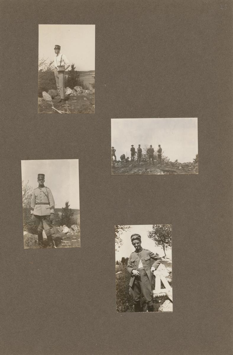 En soldat från Södermanlands regemente står på en kulle.