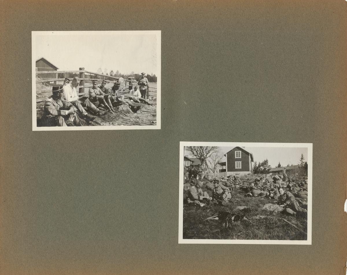 Soldater från Göta livgarde I 2 har paus på gräsmattan framför ett trähus.