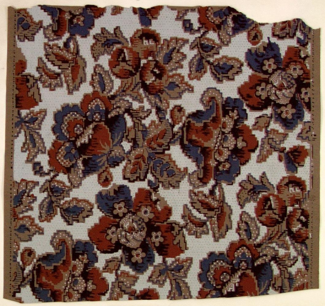 Ett ytfyllande silhuett-/blommönster i chokladbrunt, turkos, ljusblått och svart på ett grått genomfärgat papper. Delvis övertryck med prickmönster.