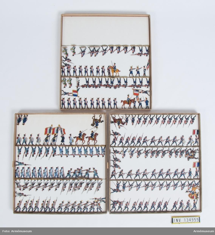 Infanteri, lätta fysiljärer, från Frankrike från Napoleonkrigen. Tre lådor med figurer. Fabriksmålade.