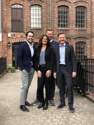 Kom med gode nyheter til Østfoldmuseene. Fra v. Michael Torp, Finn Erik Blakestad, Hege Hauge Tofte og Tage Pettersen foran Moss by- og industrimuseum.