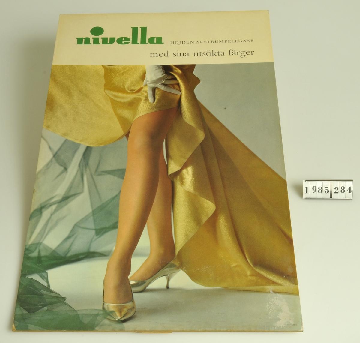 """Text: """"Nivella höjden av strumpelegans med sina utsökta färger"""".  Motiv: Damben:: draperat tyg."""