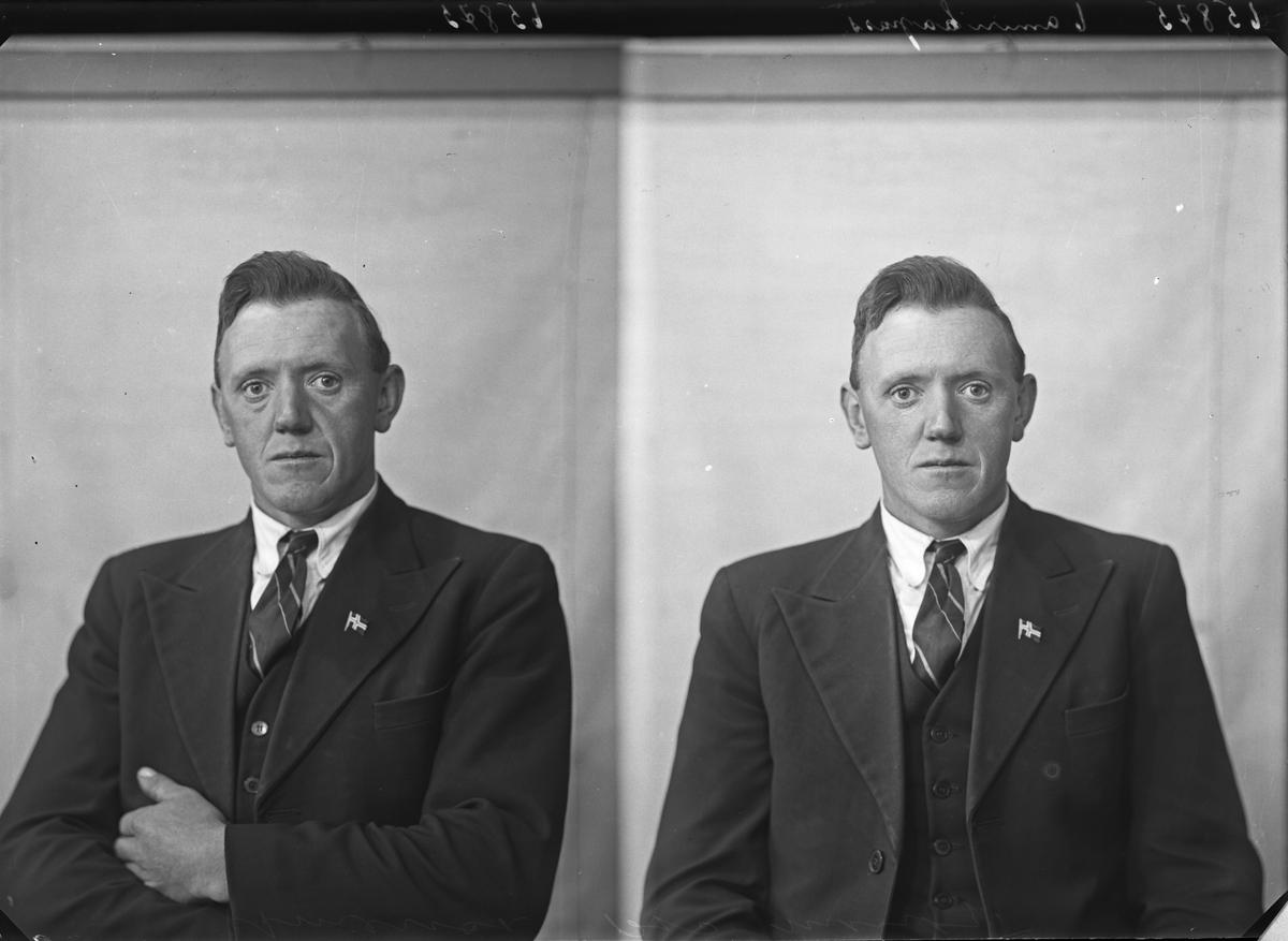 Portrett. Mann i mørk dress med det norske flagget på kragen. Bestilt av Klefford Jakobsen. Kolstø. Håvik.