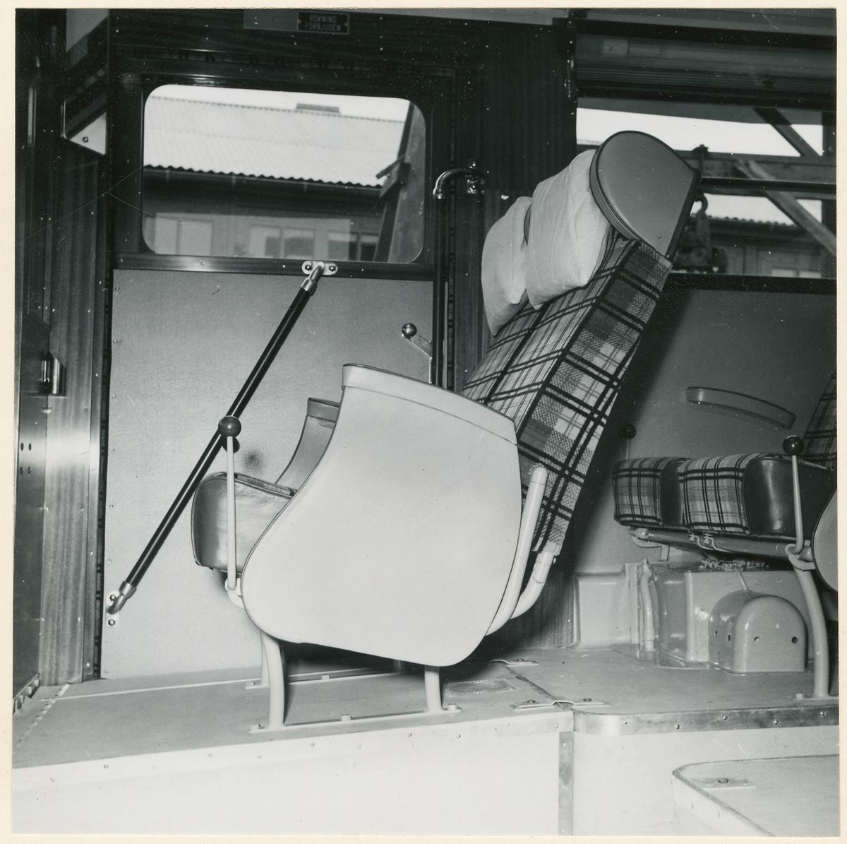 Passagerarstolar i buss.