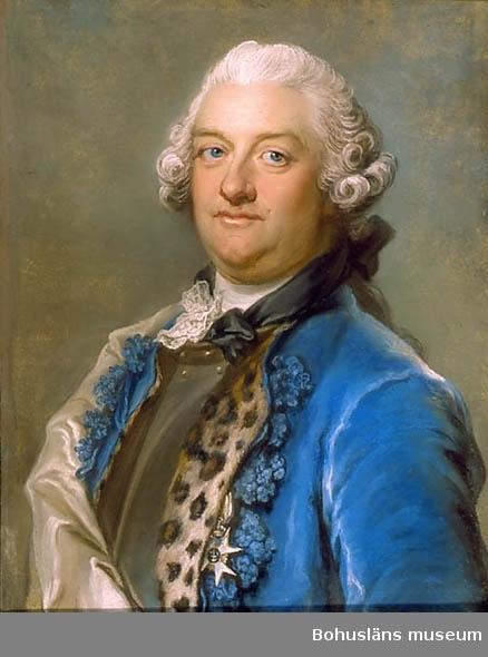Adelsman i 1700-talsdräkt med peruk och ordenstecken