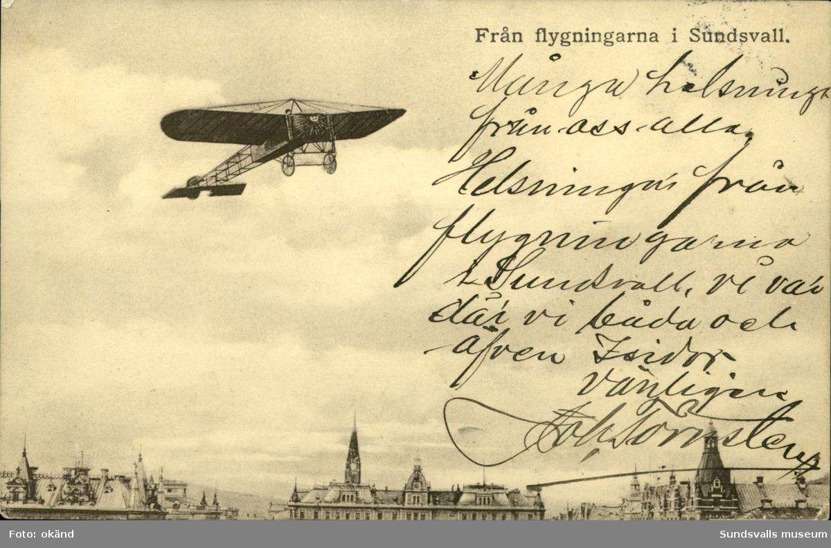 Vykort över en flygplansuppvisning i Sundsvall.