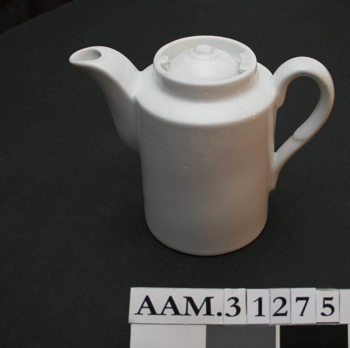 Liten, sylinderformet kaffekanne med lokk.