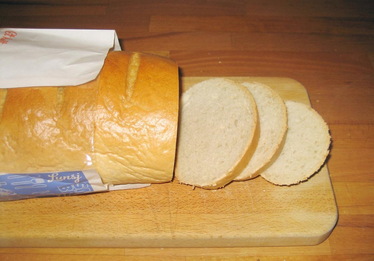 Brødposen er uten motiv. Brødets navn - Et helt alminnelig brød - er fremhevet på posens forside