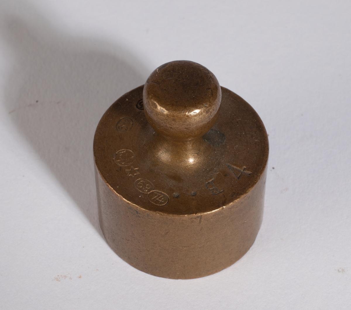 Ett sylinderlodd med håndtak.