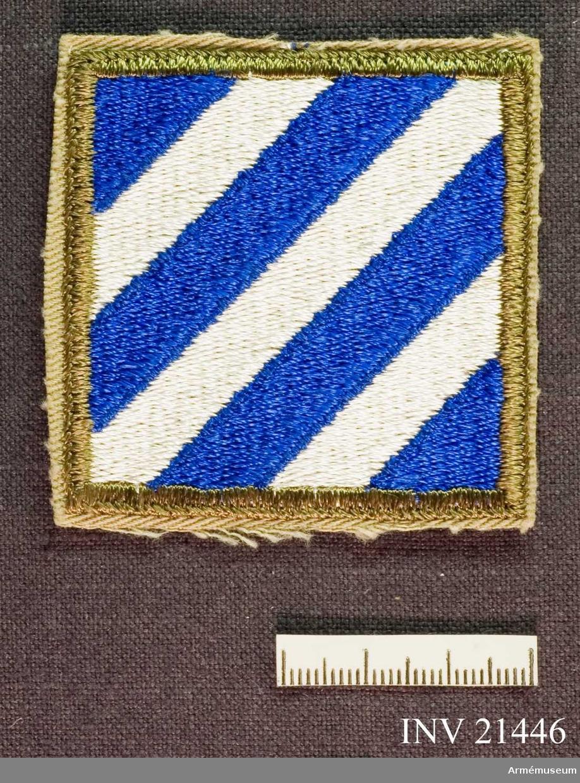 Samhörande gåva: 21437-51, 22351-2, uniformsemblem.Emblem, 3rd Infantry Division. Grupp C I. För amerikansk trupp som deltog i striderna i Korea 1950-53. USA 3d Infantery Division: deltog i Korea-kriget.
