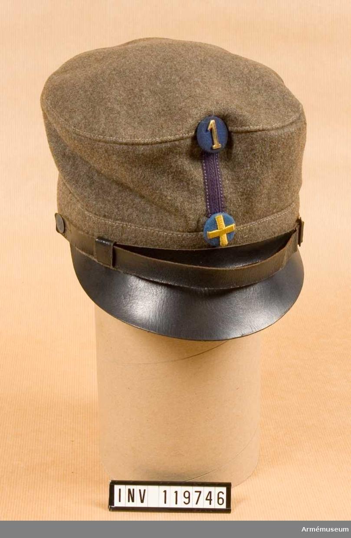 Grupp C I. Uniform bestående av: Vapenrock m/1923, Ridbyxor samt Mössa m/1926.