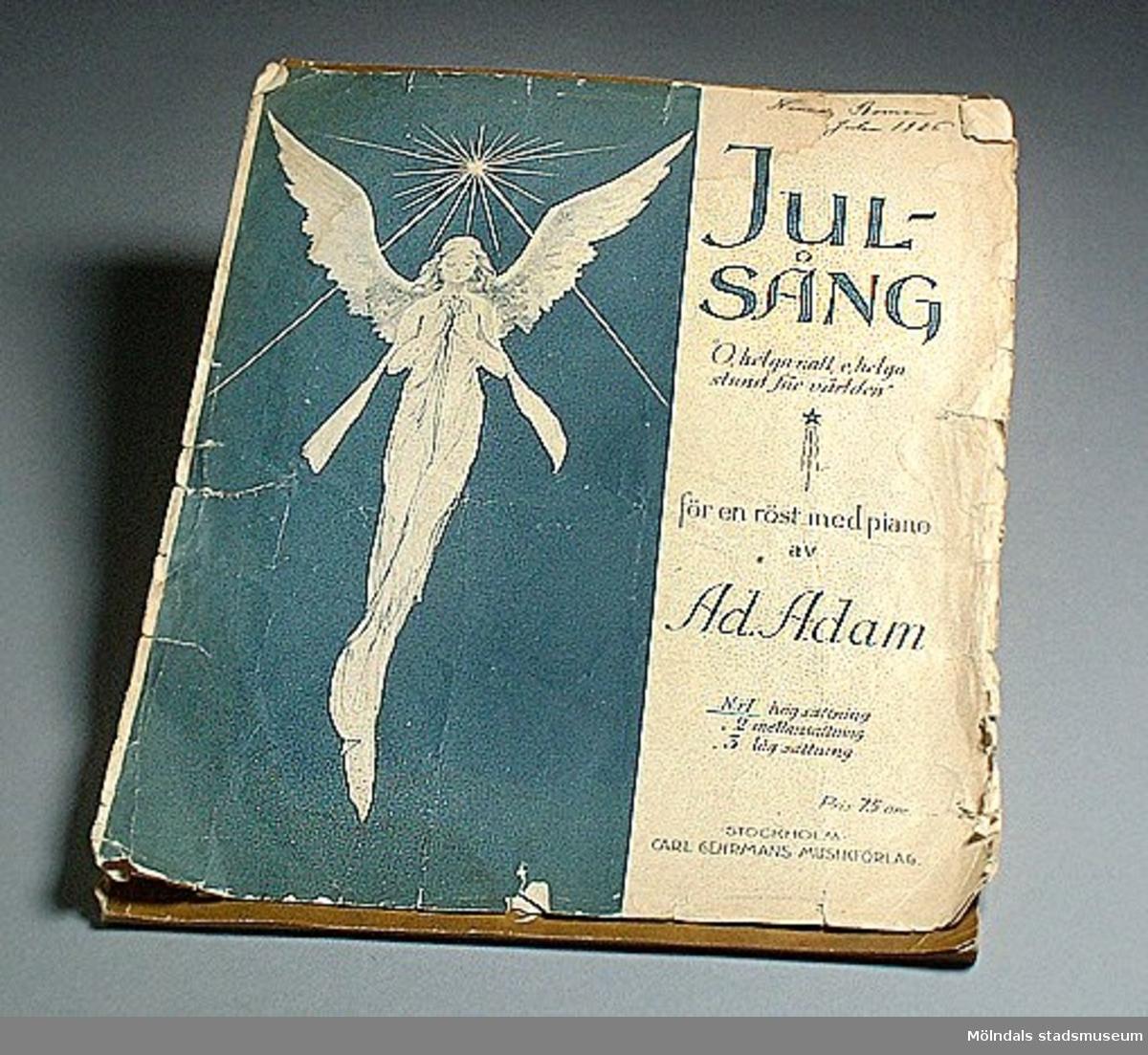 """Nothäfte med julsång """"O, helga natt, o, helga stund för världen"""" för en röst med piano av Ad. Adam med påskriften: Nanna Boman julen 1926.Välanvänd."""