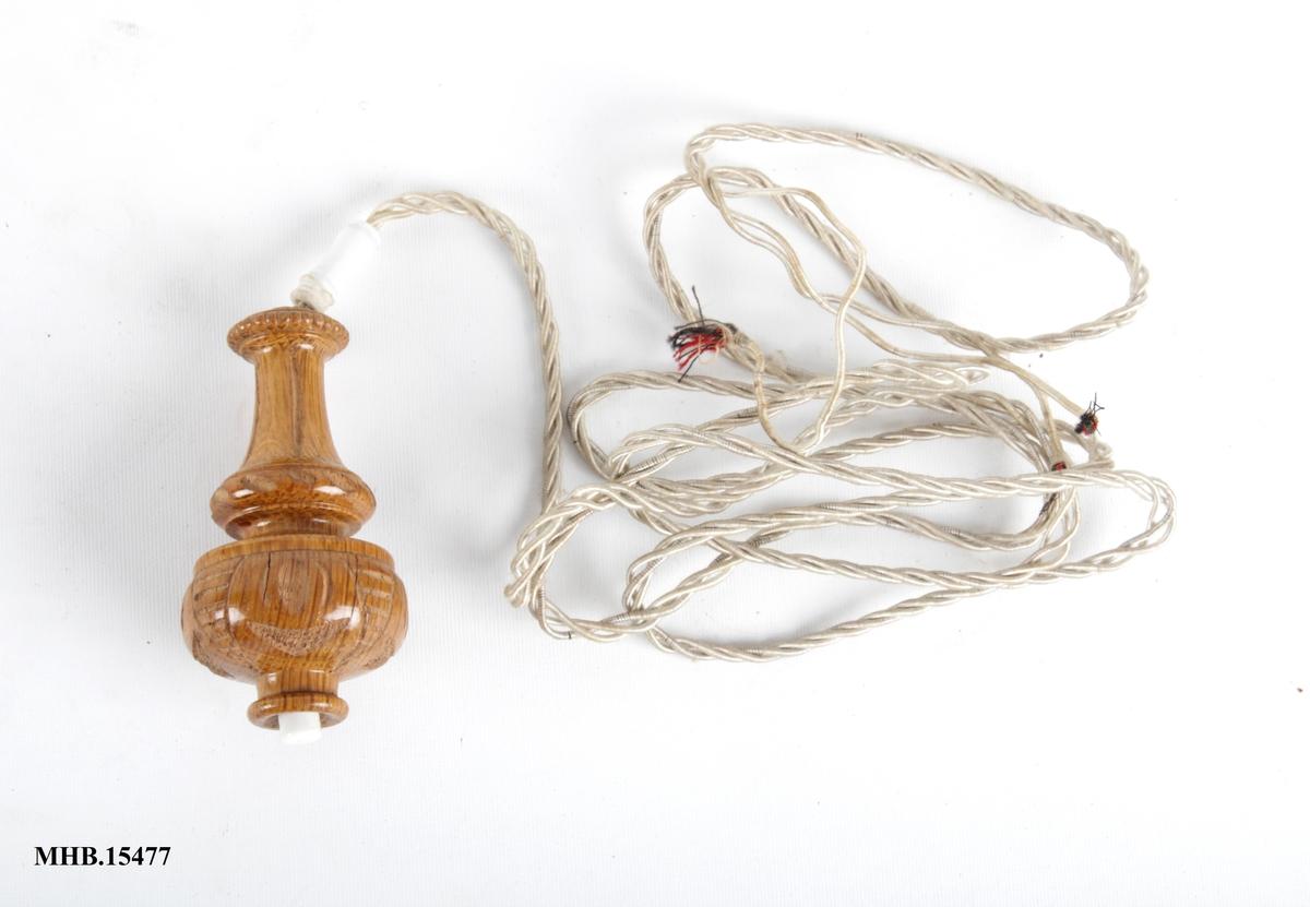 Ringeknapp eller lysbryter med ledning.