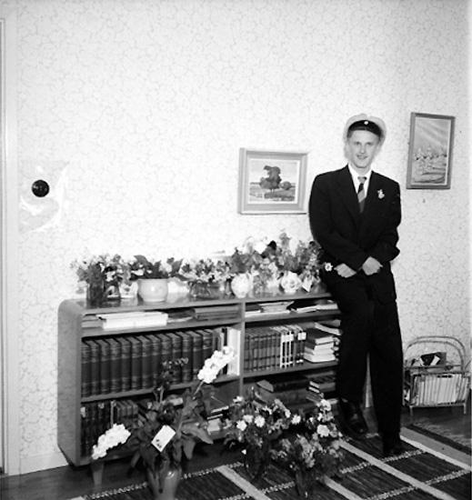 Rumsinteriör, en student.Filip Anderssons studentexamen.