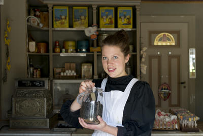 Woman in the Grocery Store holds a candy jar