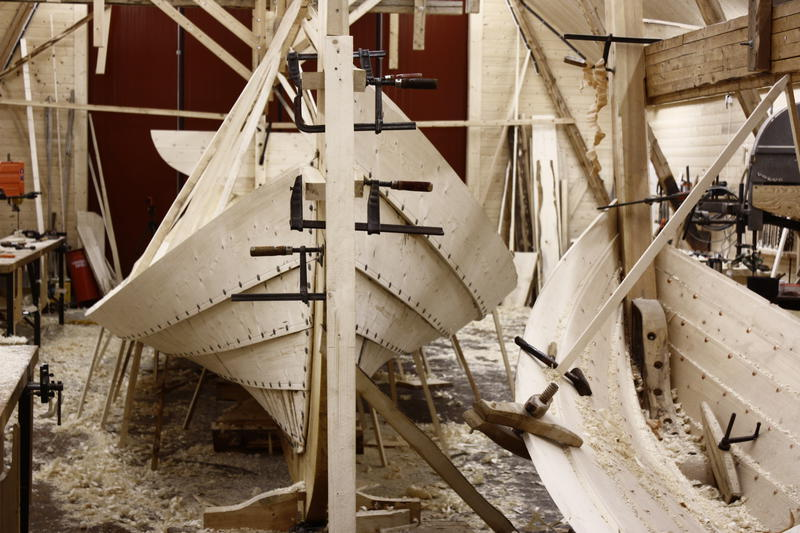 An åfjord boat and a sjark in the making.