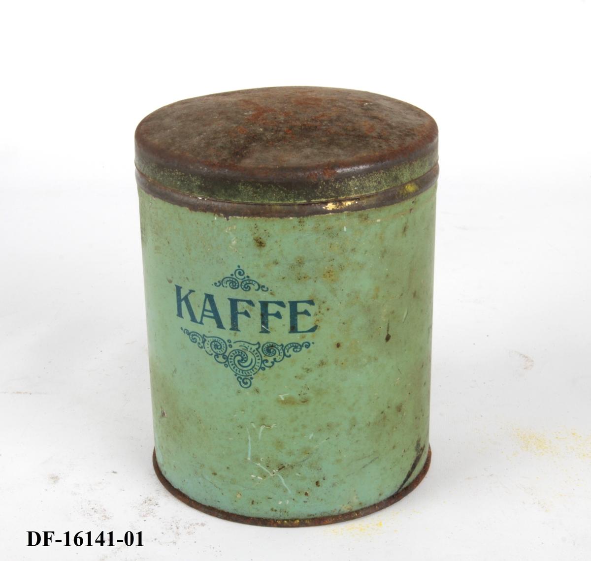 Rund boks med lokk. Brukt til oppbevaring av kaffe.