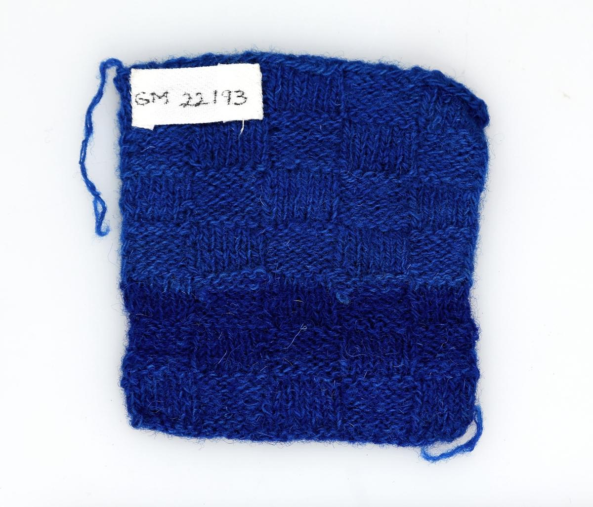 Firkantet lapp i strikket rutemønster
