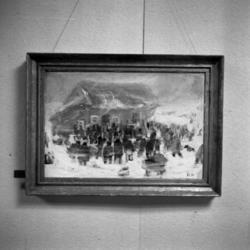 Närbild av en tavla med en snöstorm och folksamling vid ett